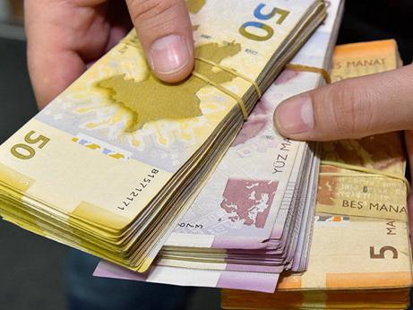 Средневзвешенный курс маната укрепился к доллару США