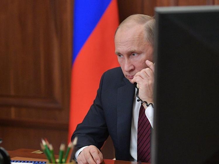 Путин обсудил с Меркель международные проблемы